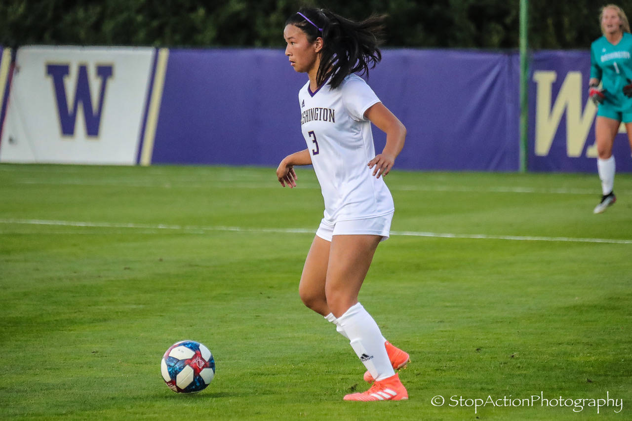 Issaquah High alumnus Kaylene Pang (pictured) plays defender for the University of Washington soccer squad during its Aug. 26 home match against Seattle University. Karlee Steuckle, formerly of the ISC Gunners, played forward during the match. After two overtimes, the final score was 0-0. Photo courtesy of Don Borin/ Stop Action Photography