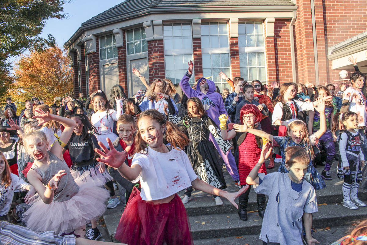 "Natalie DeFord/Staff photo                                 Hundreds participate in Oct. 26 10th annual Issaquah Zombie Walk and flash mob ""Thriller"" dance at City Hall."